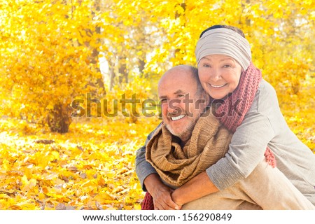 happy autumn fall couple in leaves - stock photo