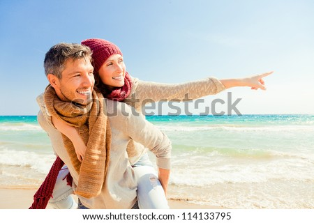 happy autumn fall couple showing with outstretched arms - stock photo