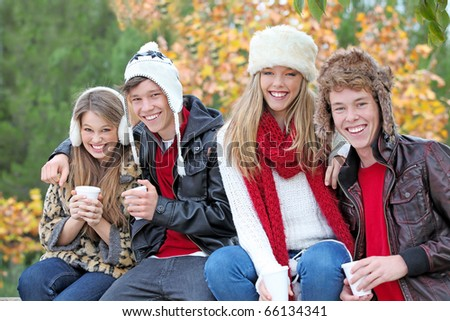 happy autumn or fall group of smiling teens - stock photo