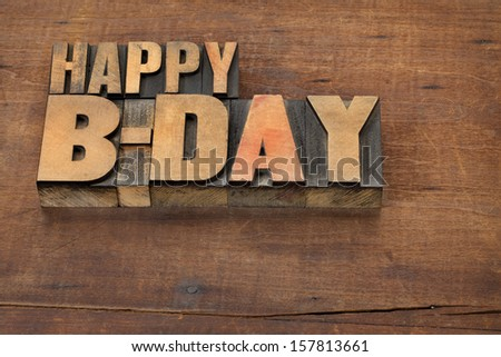 happy b-day (birthday) - text in vintage letterpress wood type on a grunge wooden background - stock photo
