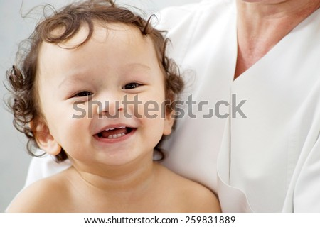 Happy baby at the doctor. - stock photo