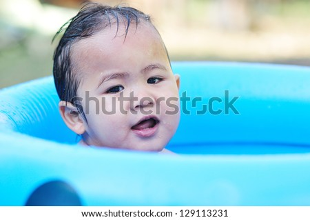 Happy baby bathing