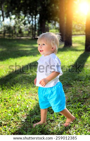 Happy Baby Boy at the Summer Park - stock photo