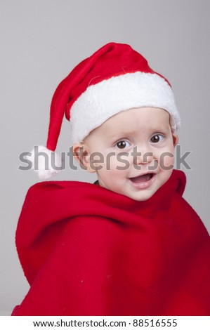 happy baby boy in Santa Claus Christmas outfit