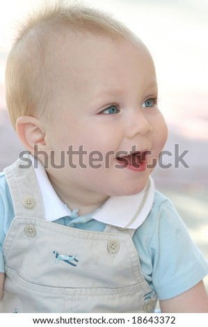 Happy baby boy, laughing and smiling - stock photo