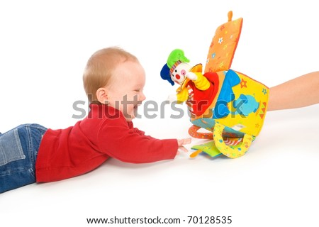 Happy baby boy (6 months old) playing with soft toys, smiling. Toys are property released.? - stock photo