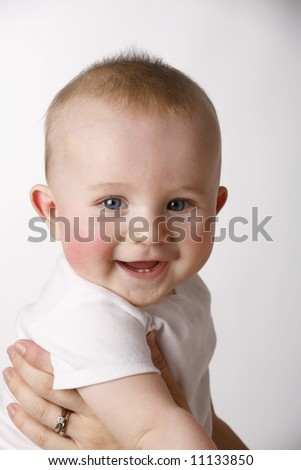 happy baby boy on a white background