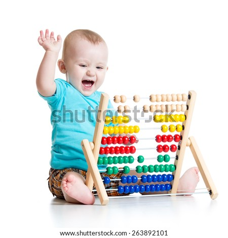 Happy baby boy playing with counter toy - stock photo