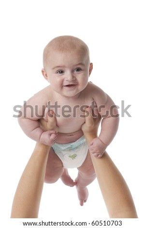 Happy baby boy up in the air on white background