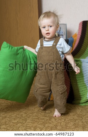 Happy baby boy ( 2 years old ) holding pillow - stock photo