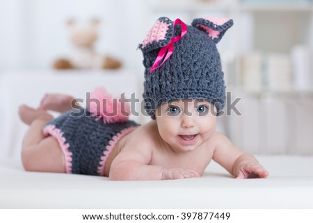 happy baby child in costume a rabbit bunny  - stock photo