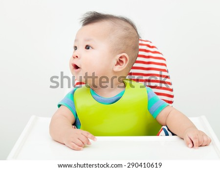 happy baby child sitting in chair