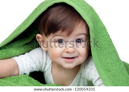 Happy baby covered with a green towel isolated on white background - stock photo