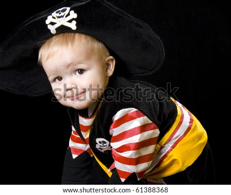 Happy baby crawling in a pirate costume