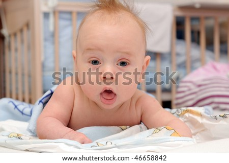 Happy baby crawling in bed