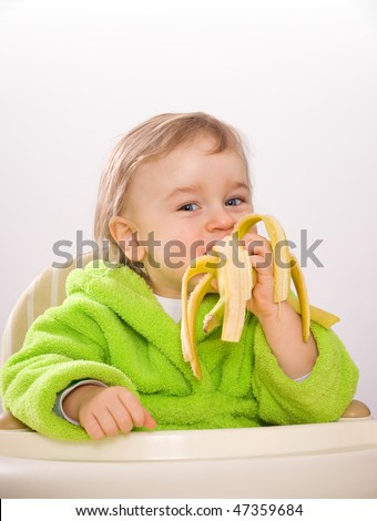 happy baby eating banana
