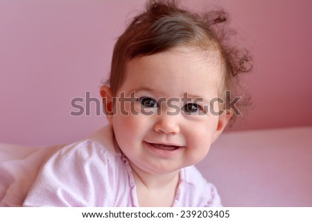 Happy baby (girl age 06 months) smiles. Concept photo childhood. copy space - stock photo