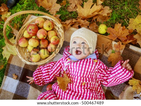 happy baby girl having a picnic in the autumn park