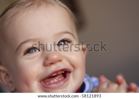 happy baby girl laughing with teeth showing - stock photo