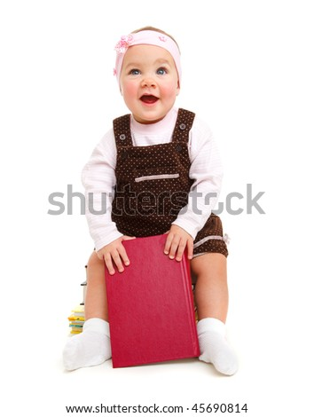 Happy baby girl sitting on books stack
