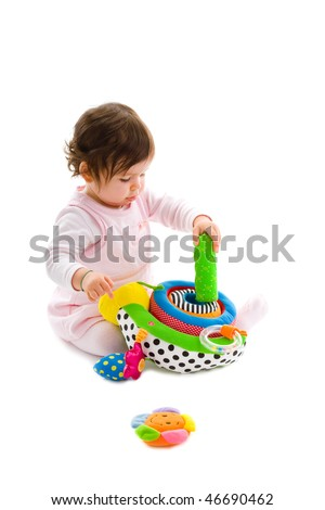 Happy baby girl sitting on floor playing with soft toy, smiling, isolated on white background. - stock photo