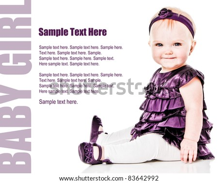 Happy Baby Girl smiling in purple dress with Text Space to the left - stock photo