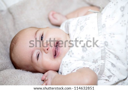 Happy baby girl smiling to camera