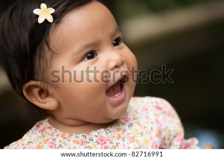 happy baby girl yelling her first words - stock photo