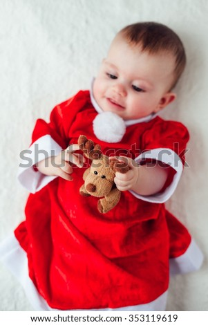 Happy baby holding a plush toy