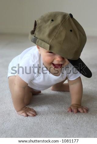 happy baby in a baseball cap - stock photo