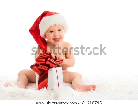 happy baby in a Christmas hat with a gift isolated on white background - stock photo