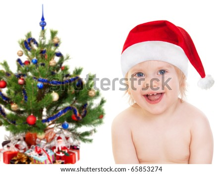Happy Baby in Santa hat under the Christmas tree isolated on white - stock photo