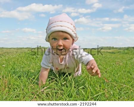 happy baby in summer meadow - stock photo