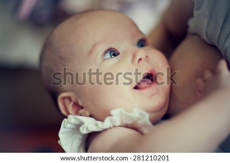 happy baby in the mother's breast - stock photo