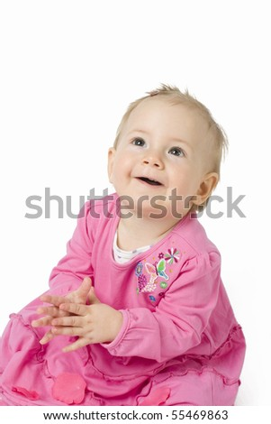 Happy baby in the pink dress