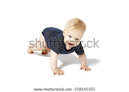Happy baby is crawling on white floor. Isolated on white background. - stock photo