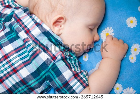 happy baby is sleeping, close-up - stock photo