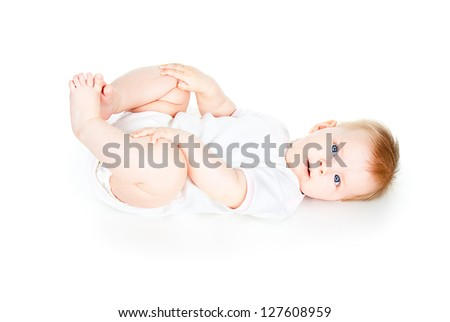happy baby lies isolated on a white background - stock photo
