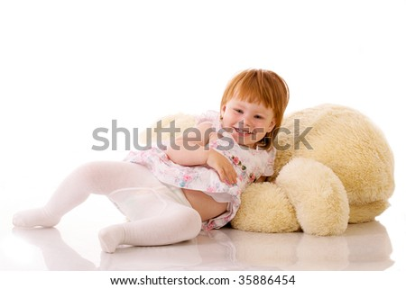 Happy baby lying in studio on white background
