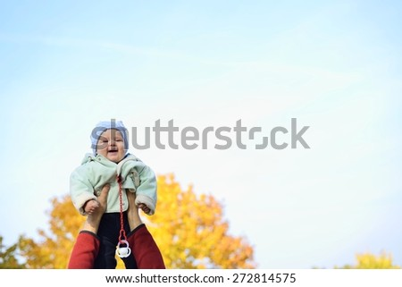 Happy baby on blue sky. - stock photo