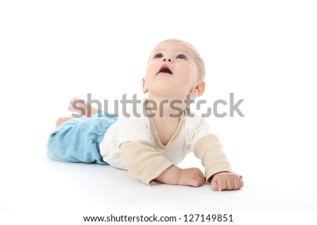 Happy baby on white background looking up, isolated, tummy time - stock photo
