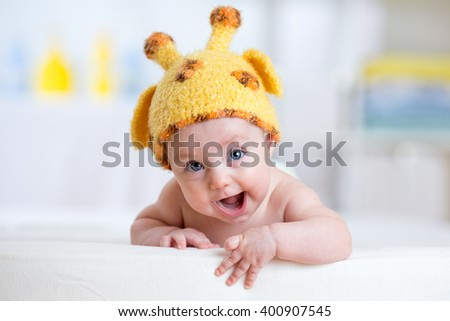 happy baby or child in giraffe costume  - stock photo
