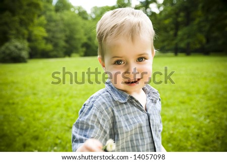 Happy Baby Playing On Field - stock photo