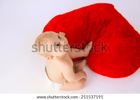 Happy baby playing with a toy, top view - stock photo