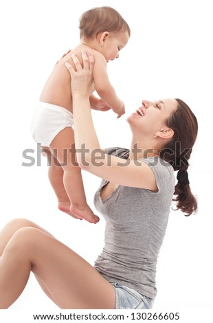 Happy baby plays with mother. Isolated on a white background.