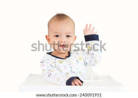 Happy baby smiling and waving hand - stock photo