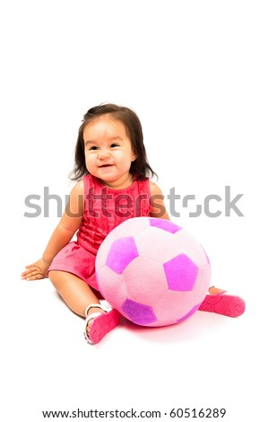 Happy baby smilling with a plush ball . - stock photo