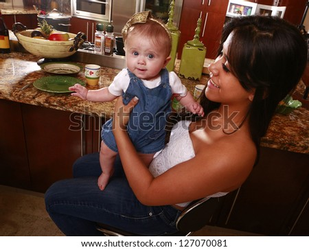 Happy baby waiting for lunch - stock photo
