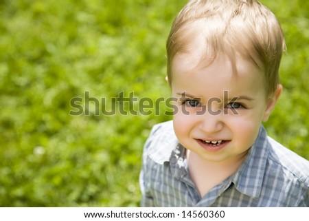 Happy Baby Walking On The Field - stock photo