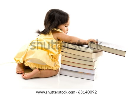 Happy Baby with a pile of books . - stock photo